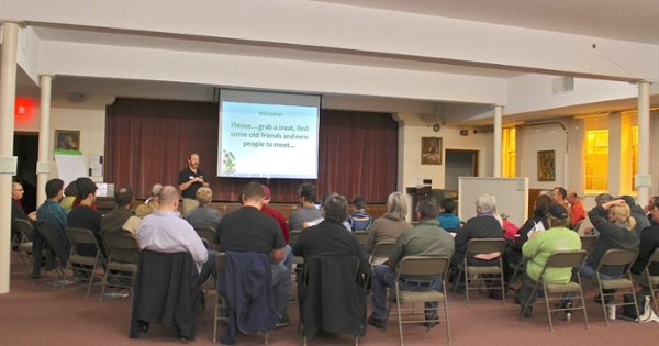 Facilitator Art Sherwood of Cooperative Development Services (CDS) welcomes owners of Viroqua Food Co-op